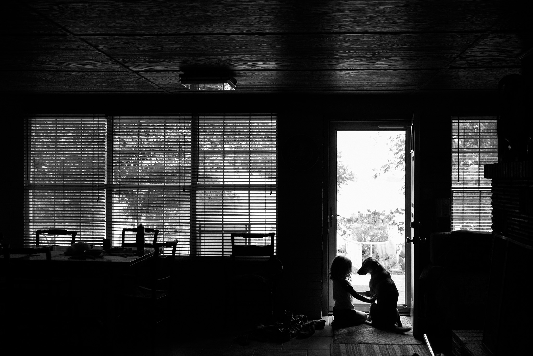 August 17: It seems like I've taken this photo of Darby many times with many children in the cabin, but this one with Quinn is a favorite.