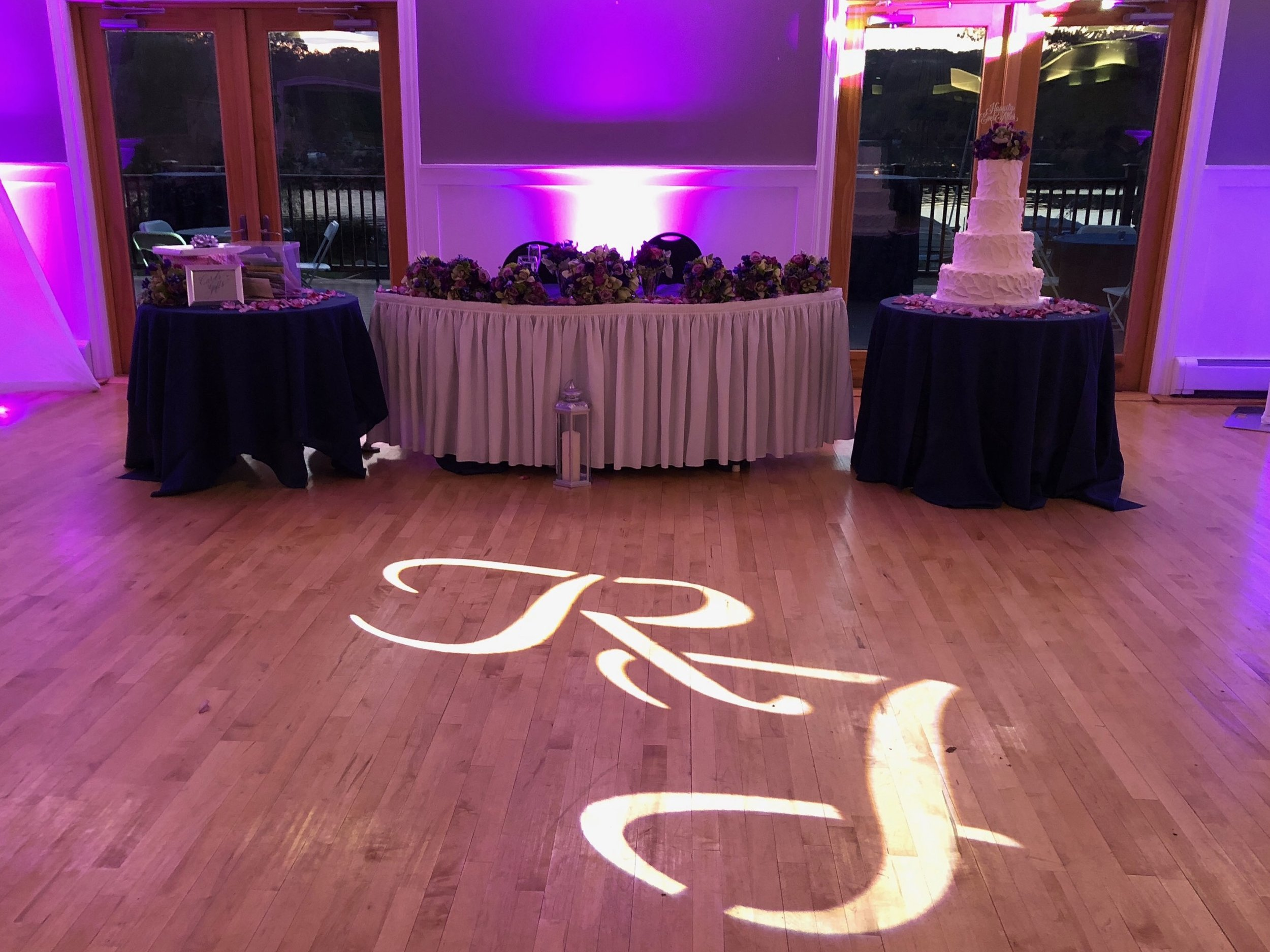 GOBO Projection - Add a personal touch to your event with a custom GOBO! Have your name or monogram displayed in lights on any wall or dance floor!