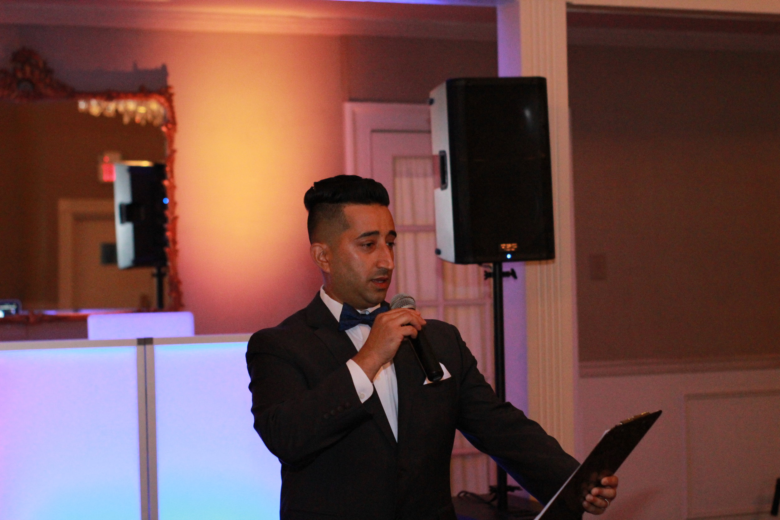 """Master of Ceremonies - A Master of Ceremonies or """"MC"""" is the formal host of an event, He is responsible for all announcements, formalities and activities as well as motivating and engaging with the crowd. An MC is essential for Weddings, Sweet 16s and Bar/Bat Mitzvahs where crowd control is key. The MC will ensure everything is running smoothly and on schedule so that you can be at ease and enjoy your special day."""