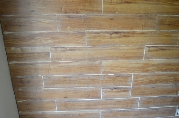 Laminate floor accent wall project. Wood filler used in each seam.