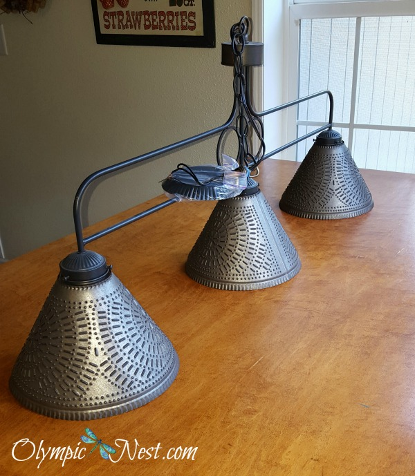 Pendant lighting adds country charm to small kitchen.