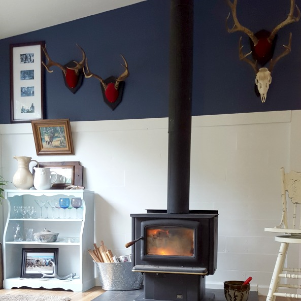 DIY planked accent wall displays his hunting tales