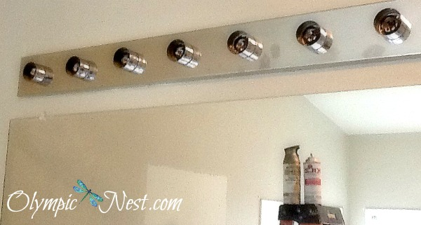 give bathroom light fixture new life with spray paint