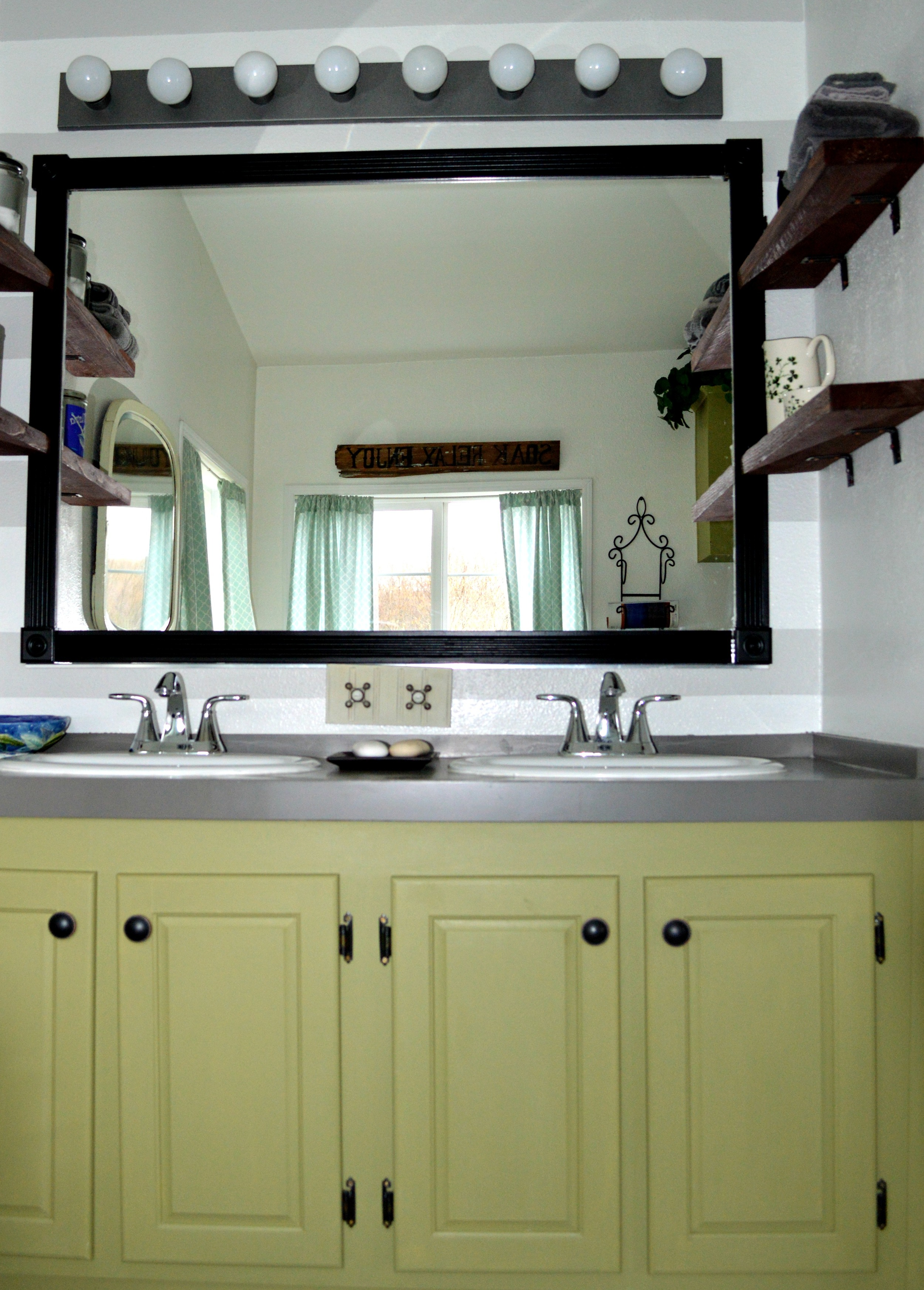 Give vanity new life with paint, trim, and hardware.