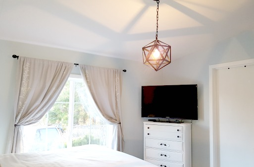 Master bedroom makeover includes geometric pendant