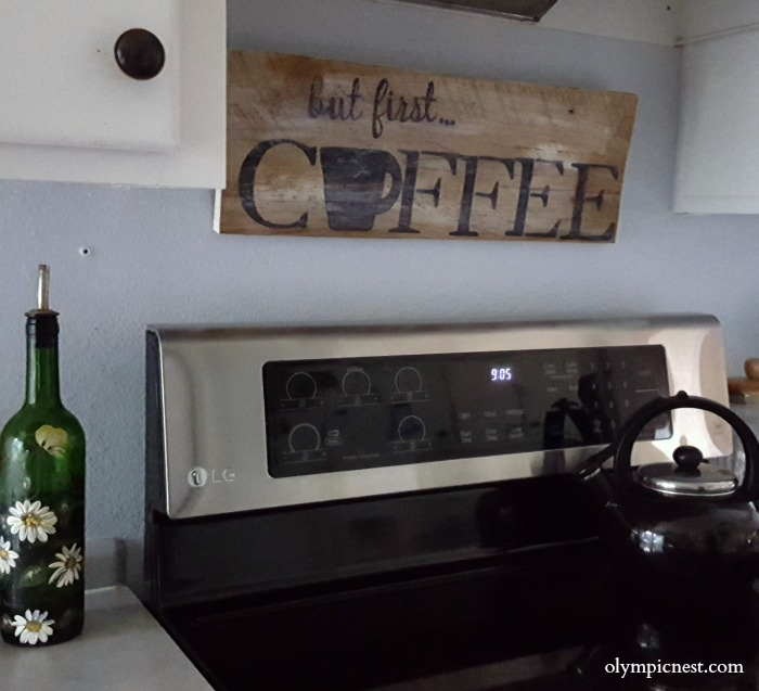 How to add extra storage in a small kitchen scrap wood over the stove shelf diy.jpg