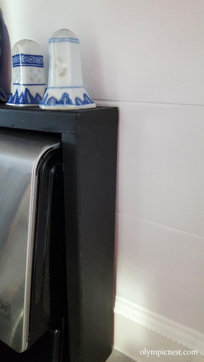 scrap wood over the diy stove shelf.jpg