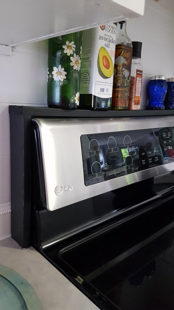 Simple diy over the stove shelf to add extra storage to a small kitchen.jpg