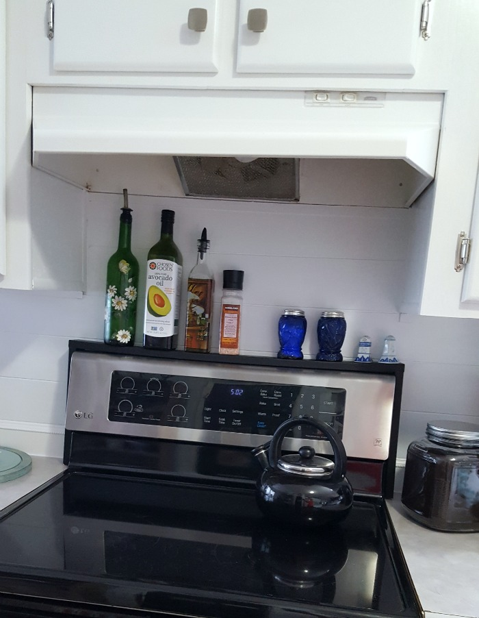 easily add extra storage to a small kitchen with this diy over the stove tutorial.jpg