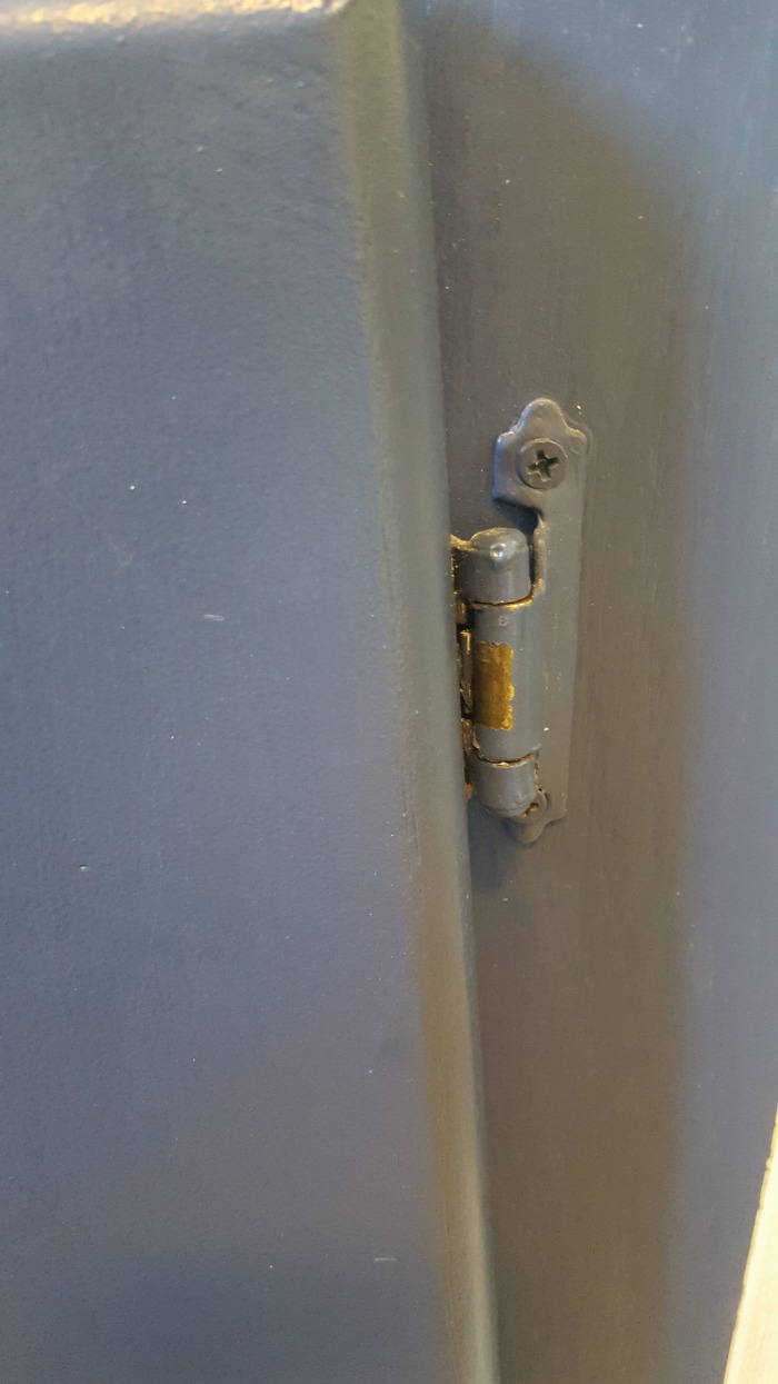 the problems with dark cabinets and painted cabinet hardware.jpg