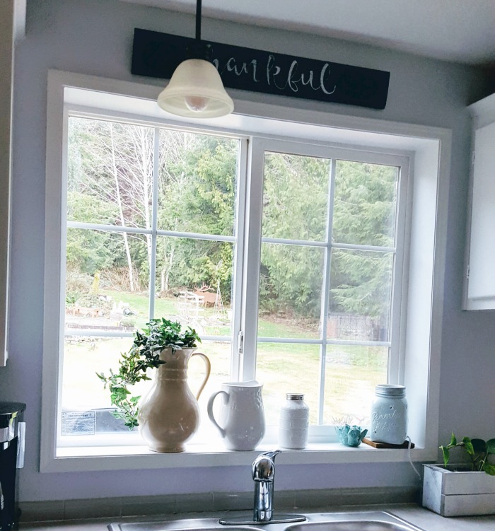 before and after a diy farmstyle window trim.jpg