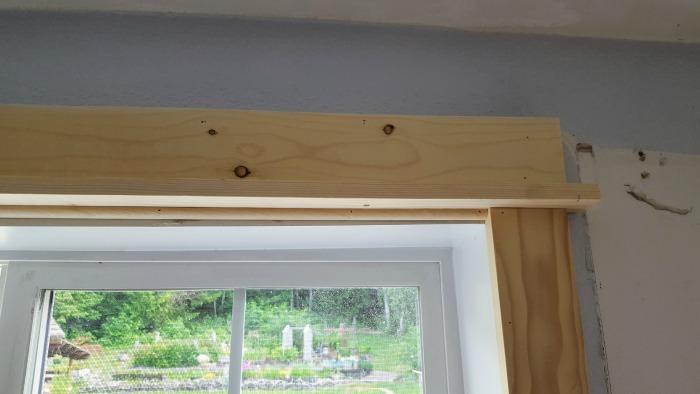 adding farmstyle window frame on a budget.jpg