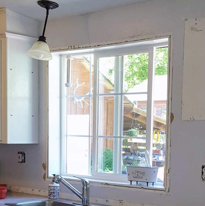 how to add farmhouse window trim to upgrade manufactured home.jpg