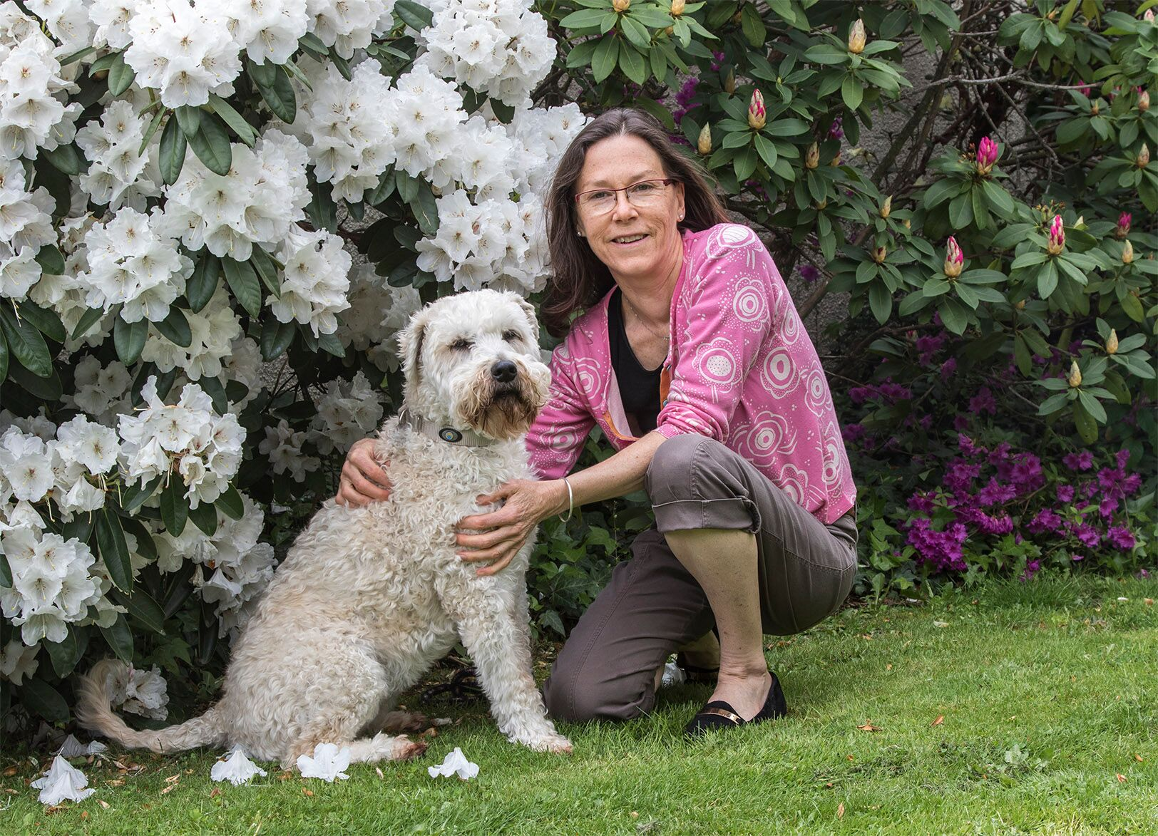 Kathy Reid Photography   Living with the seasons plays a vital role in the bio-rhythm of our health. Sara is pictured here with her family's Irish wheaten terrier, Piko, in the spring time of her garden.