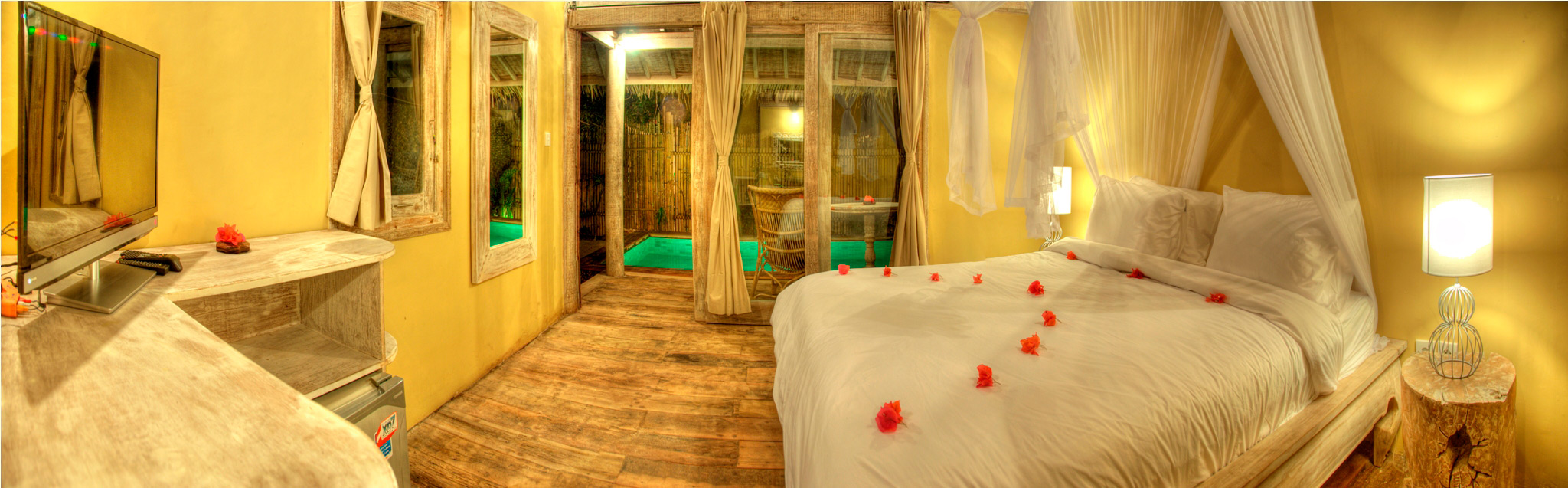 Bedroom by night in gili - Villas Ottalia