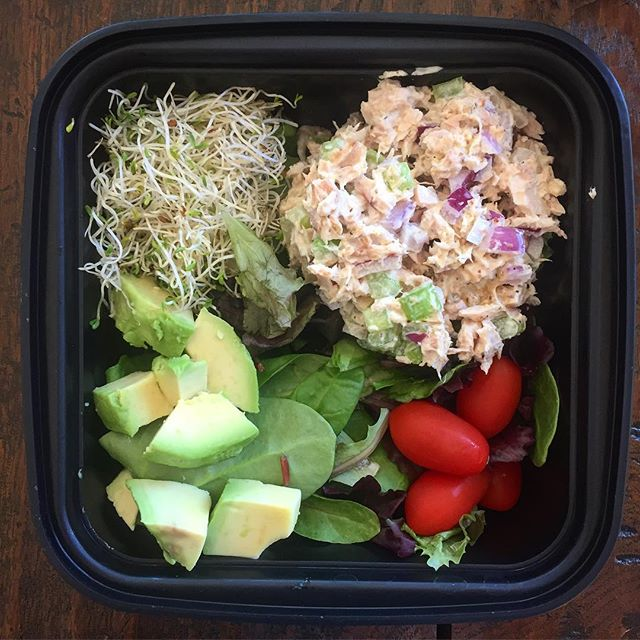 The perfect grab and go salad! Tuna salad with vegan mayo, Dijon mustard, red onion and celery, sprouts, avocado, grape tomatoes and organic field greens