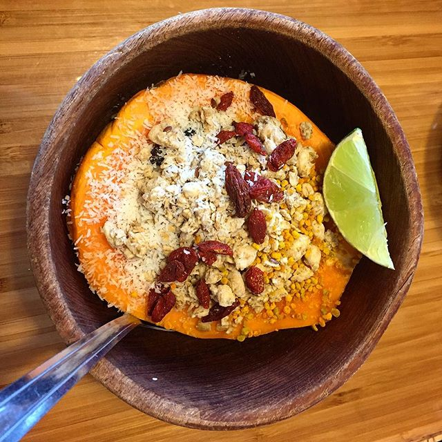Perfection. Fresh papaya with gluten free granola, goji berries, bee pollen, shredded coconut, cacao nibs and hemp seeds! #superfood galore!