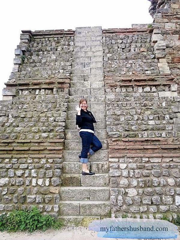 Elloise climbing a Roman wall in Istanbul myfathershusband.com