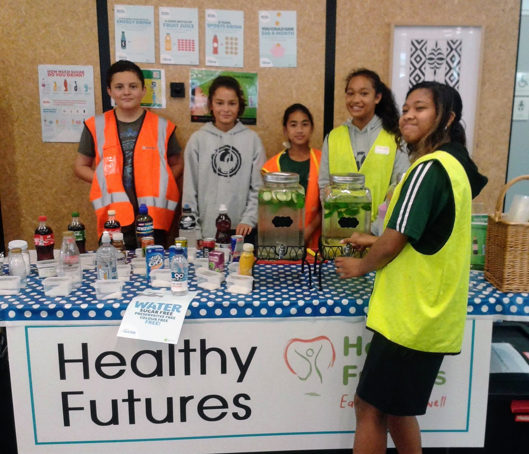 Avalon Intermediate students show their mates how much sugar is some drinks and that fruit flavoured water is a good choice at the Avalon Park Expo.