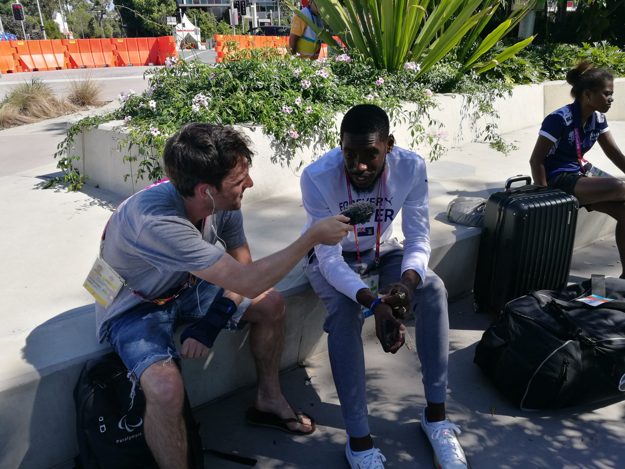 Reporter Tom Ellis (L) speaking with Kyron McMaster during the Commonwealth Games in Australia