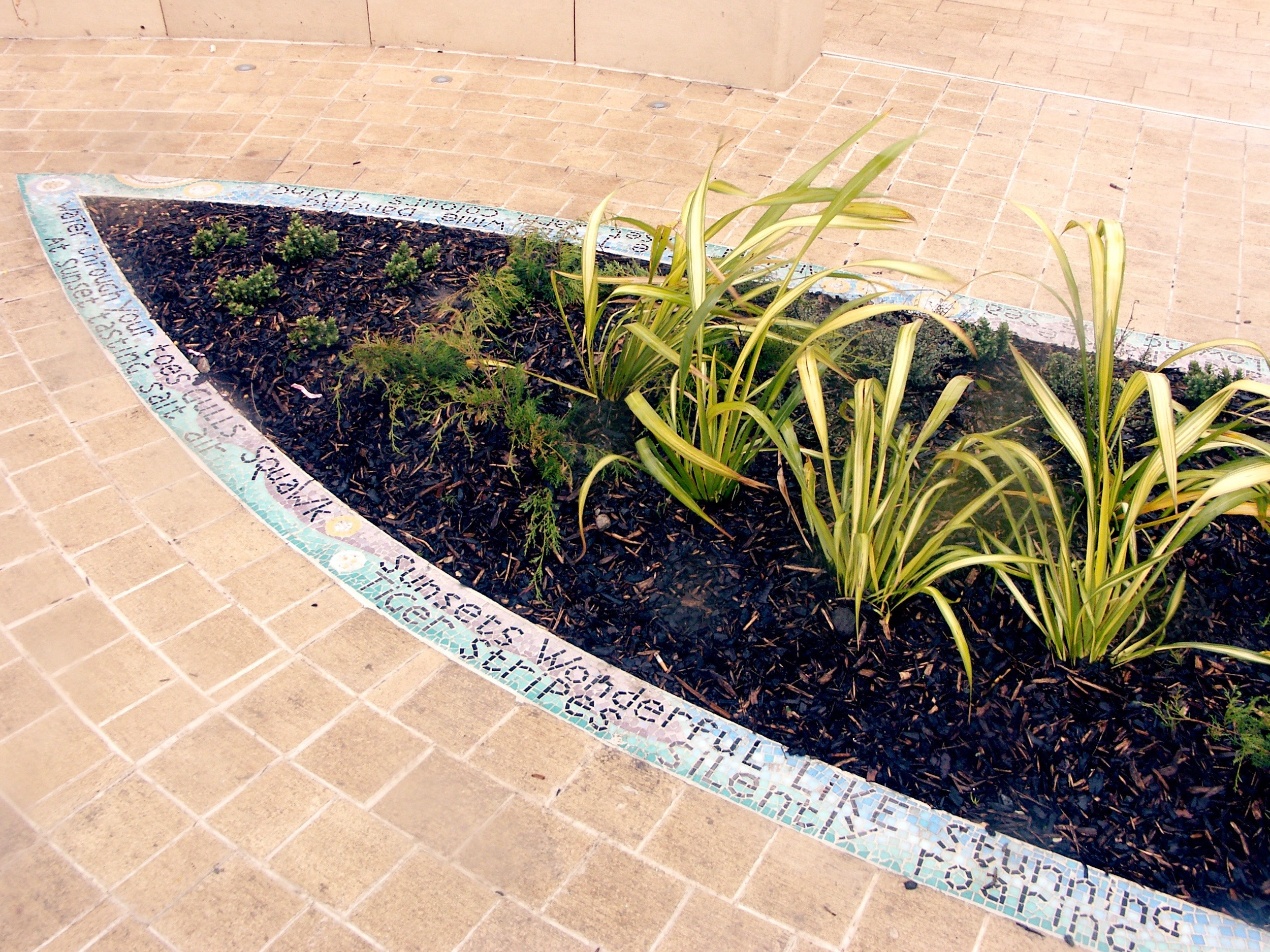 Mosaic flowerbeds and planters