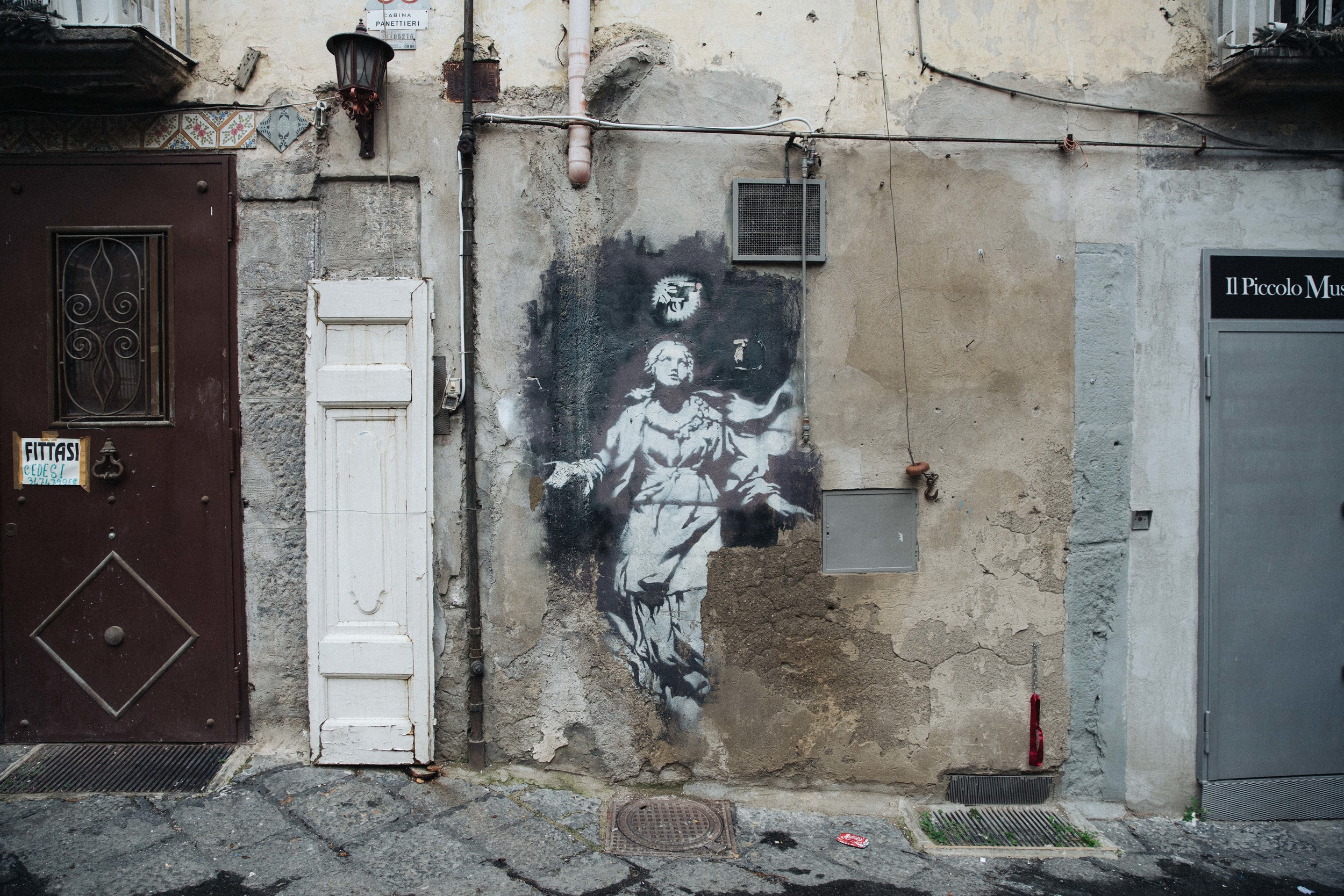 Banksy street art in Naples historical disctrict