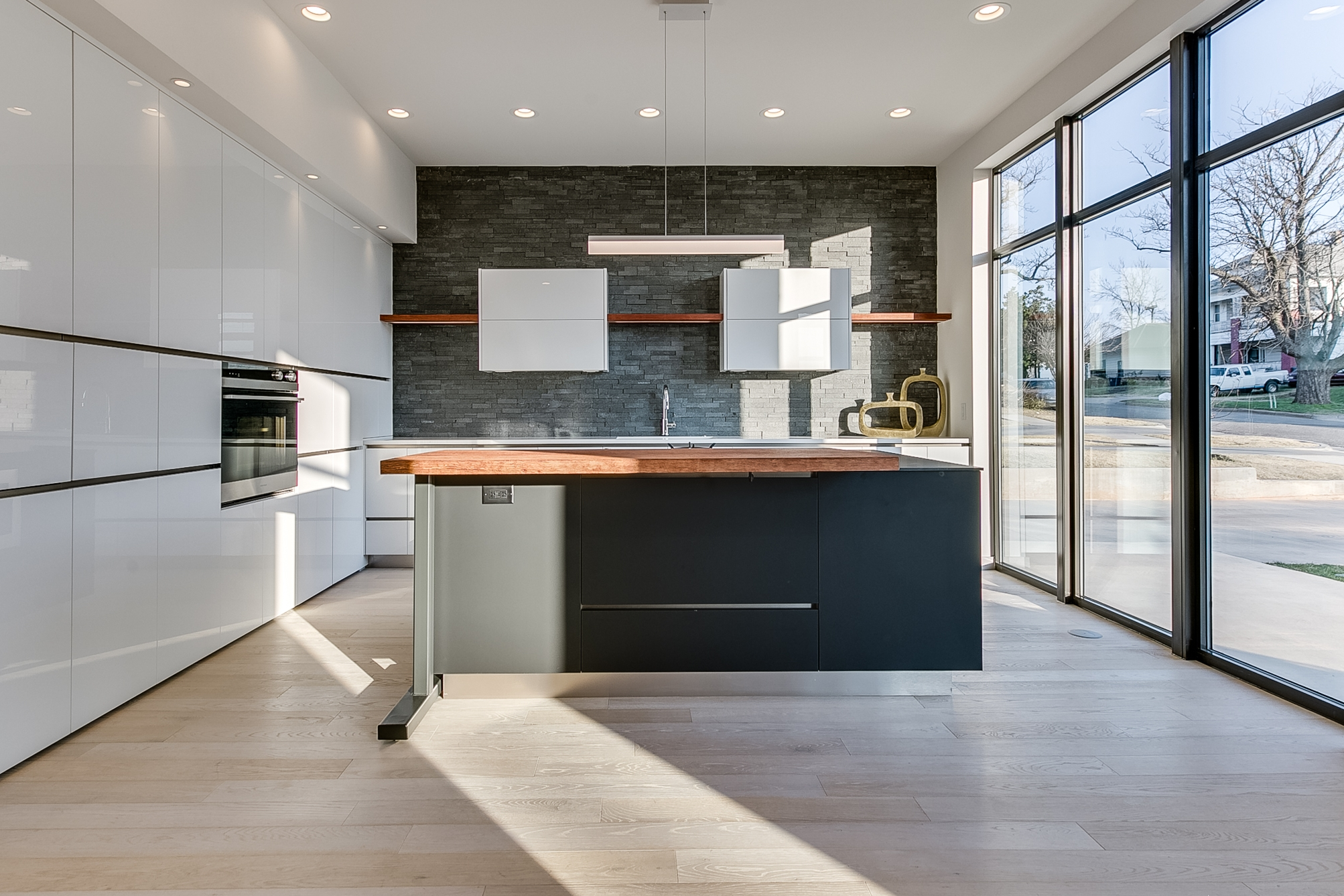 Kitchen - Clear counters of food, dish racks and cutting boardsRemove magnets, photos and papers from refrigeratorHide garbage cans, brooms, mops etc.Remove any large countertop appliancesRemove dishes from sink