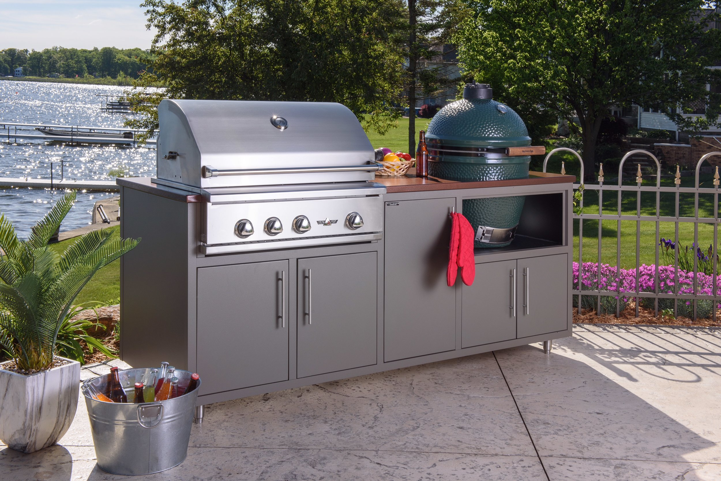 """ONLY $5,836!  Model 17COGI-82 is 82"""" wide (30"""" deep) and includes a Delta Heat 32"""" Grill (LP or NG), a 30"""" Large Green Egg, two double door cabinet, and a tall single door cabinet.  (With Infrared Rotisserie $6,010. With Rotisserie and Sear Zone $6,126)  Color pictured is Grey Glimmer with Silver Vein counter-top. Also available (in stock) in Cappuccino with Copper Vein counter-top!"""