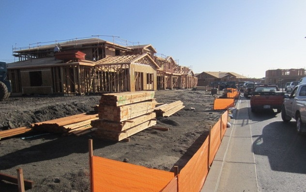 Image of residential construction site, house being built.
