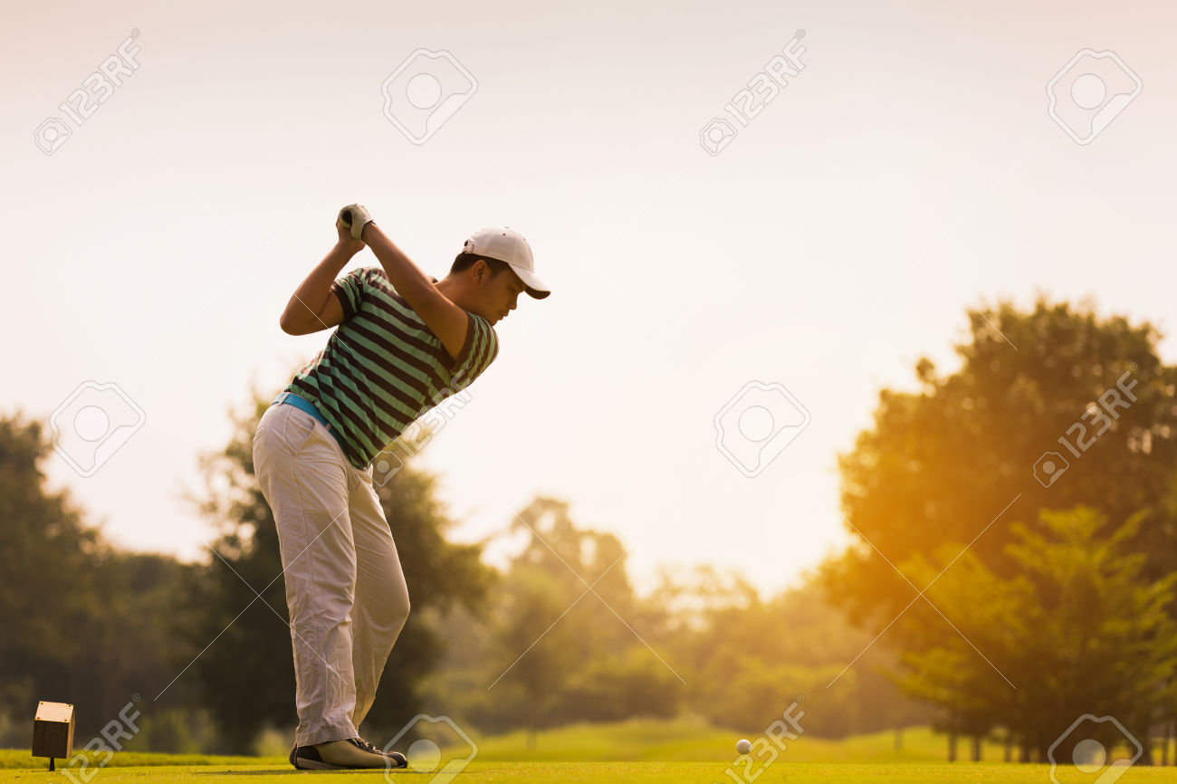 36086782-Golfers-are-going-to-hit-a-golf-ball-On-the-golf-course-during-the-summer-Stock-Photo.jpg