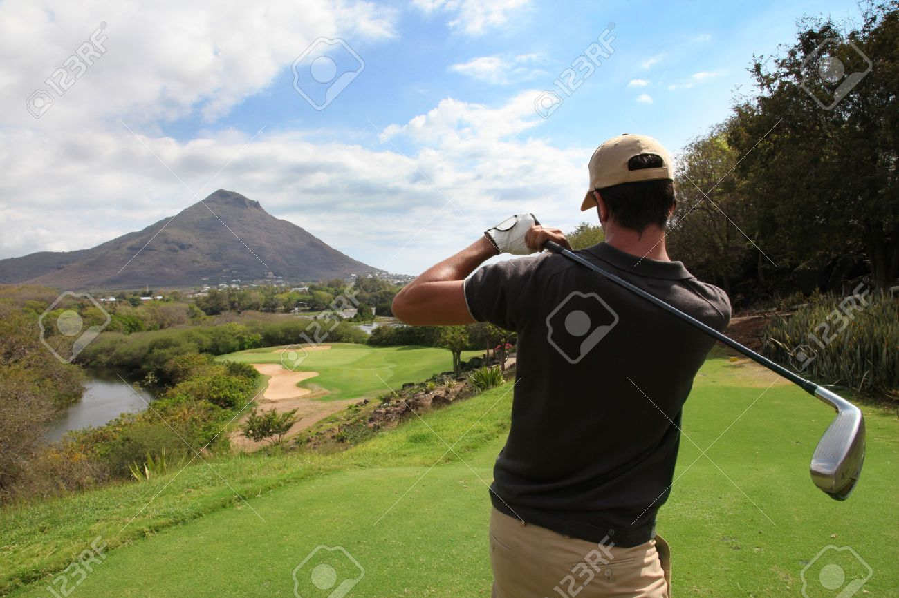 11283468-Back-view-of-man-playing-golf-Stock-Photo.jpg
