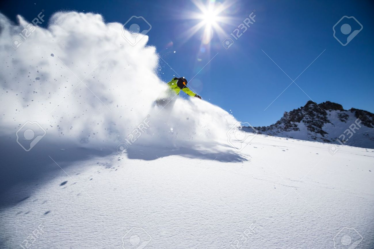 31905761-Alpine-skier-skiing-downhill-blue-sky-on-background-Stock-Photo.jpg