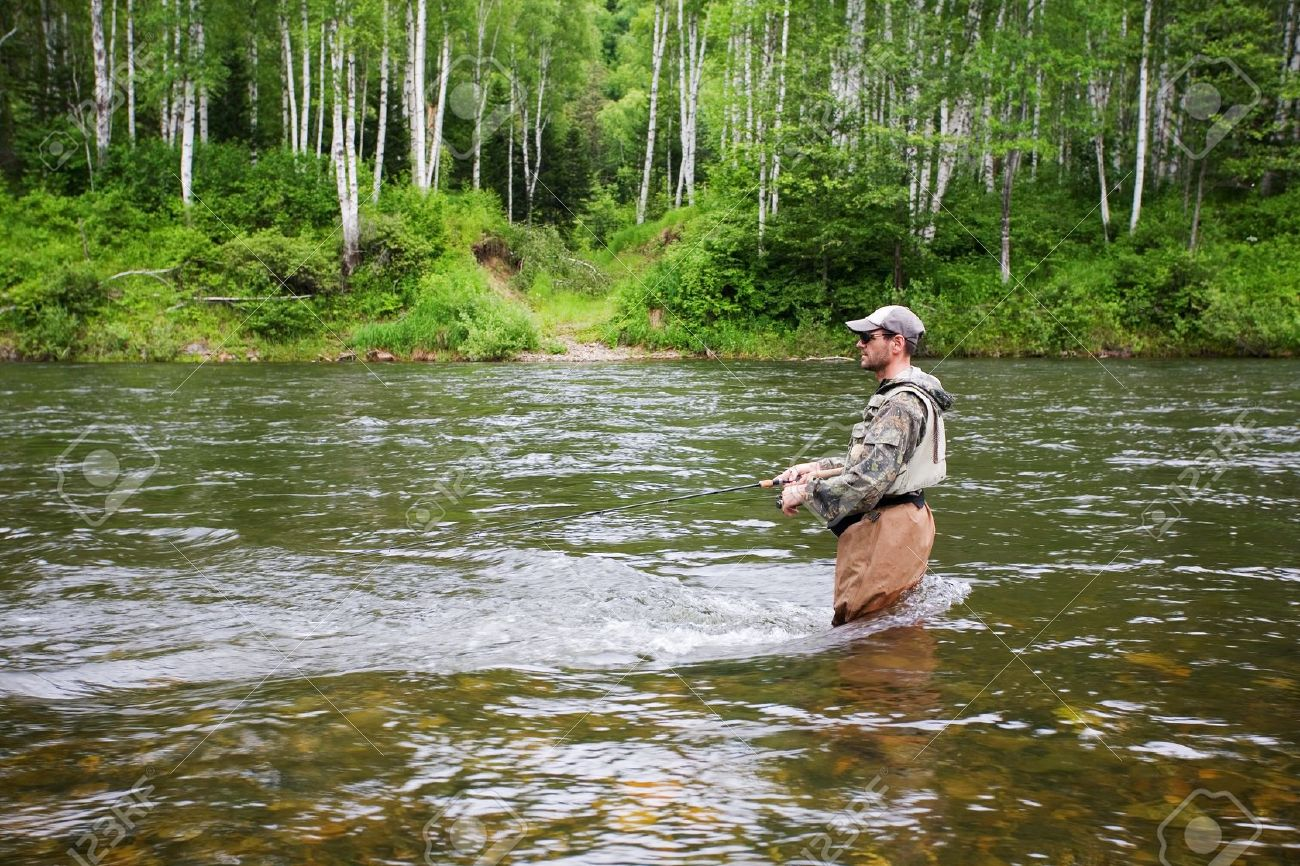 12064947-Fisherman-catches-of-salmon-and-trout-in-the-river--Stock-Photo.jpg