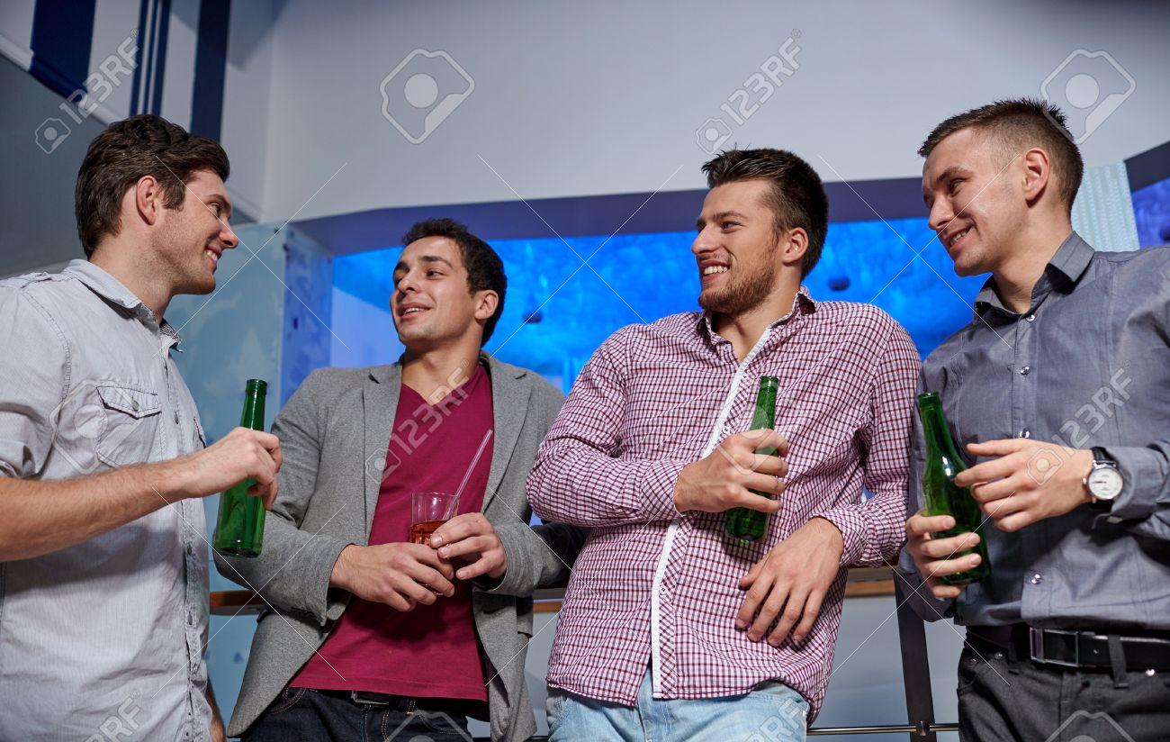 37054579-nightlife-party-friendship-leisure-and-people-concept-group-of-smiling-male-friends-with-beer-bottle-Stock-Photo.jpg