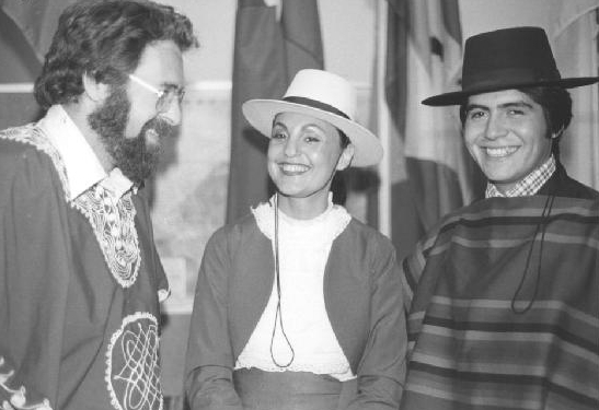 Dr. Jim Morrison at a gathering in the International Education Centre with students Maria and Juan Canales (wearing traditional Chilean dress) of Halifax. 1980. University Archives