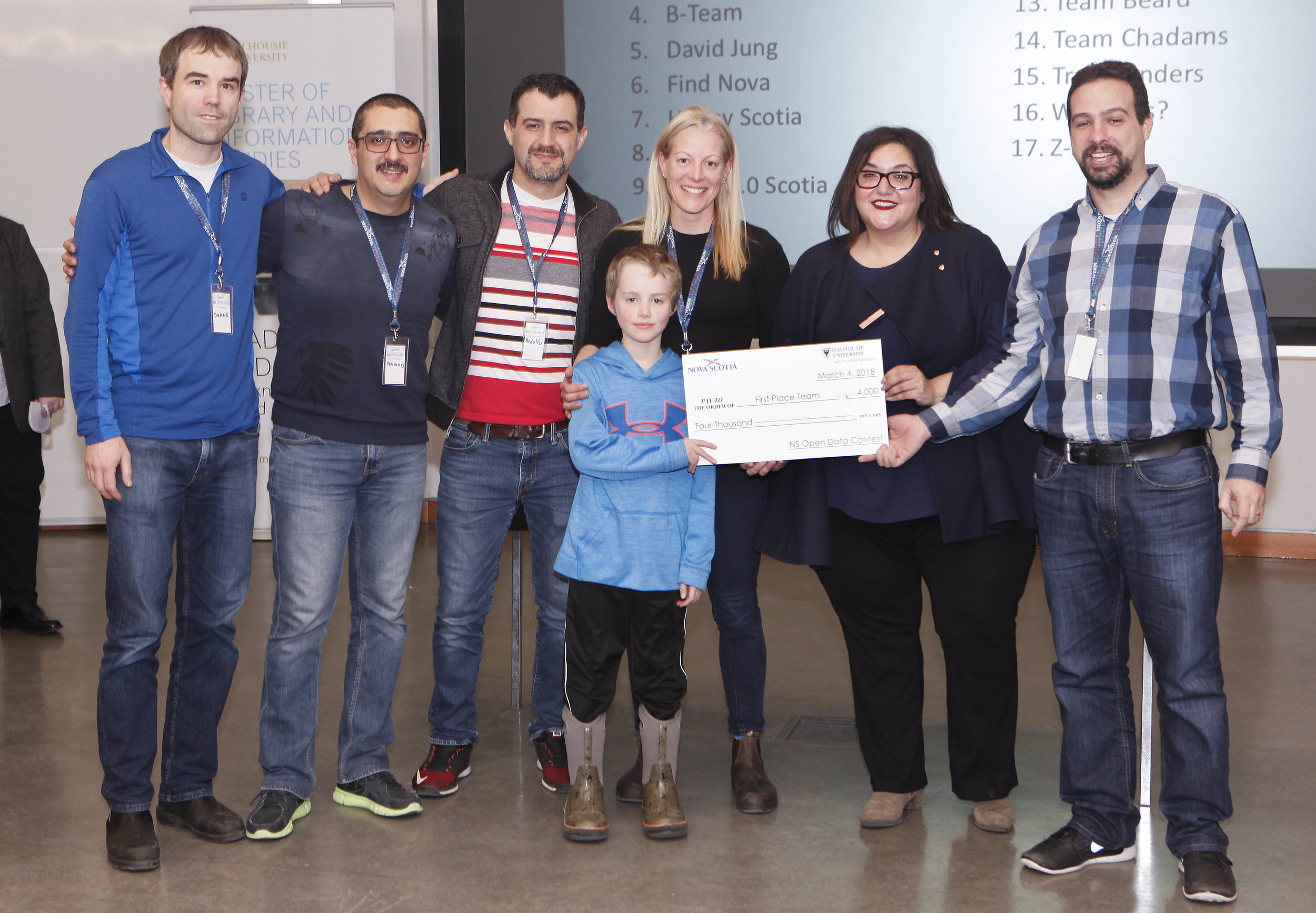 "Saint Mary's ""Bridge to NS"" top prize winning team with Internal Services Minister Patricia Arab."