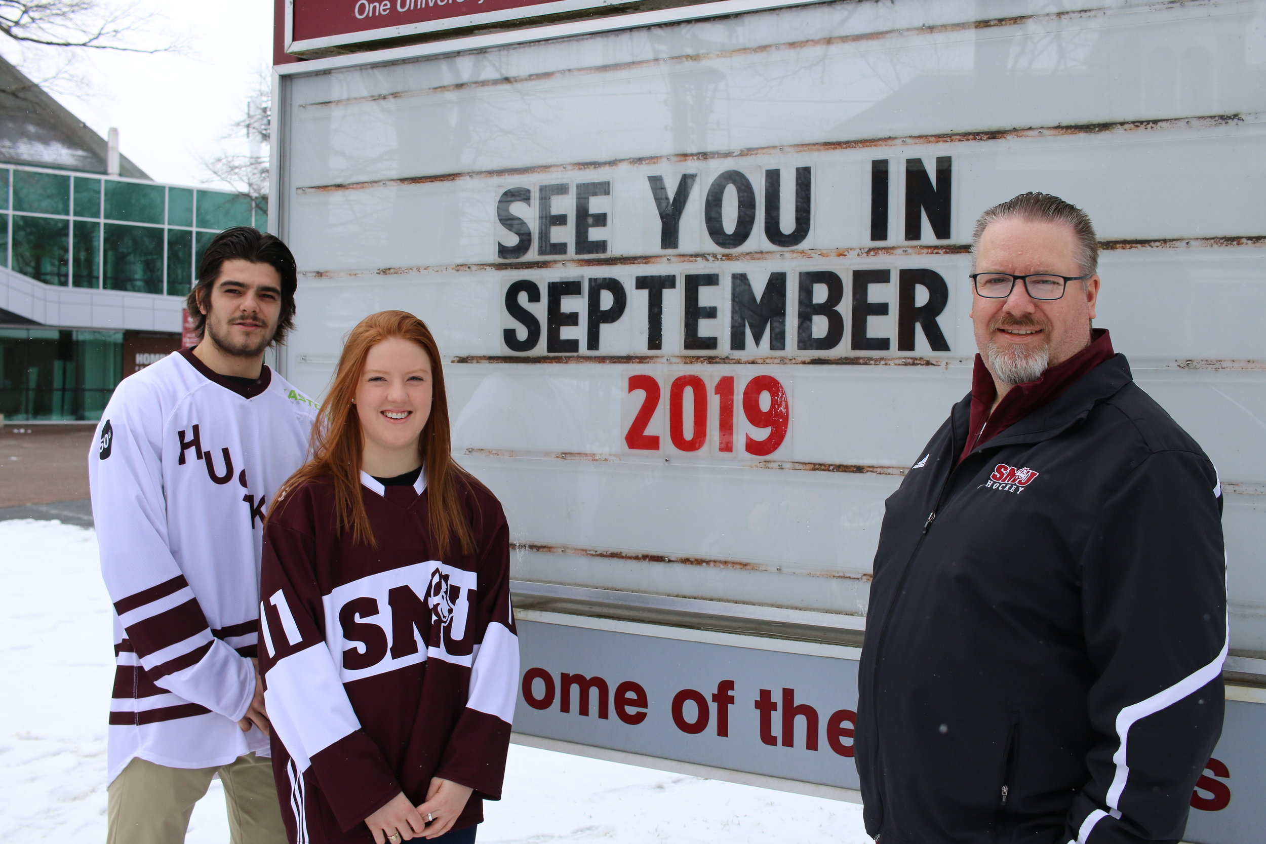 Saint Mary's Huskies Anthony Repaci (3rd year, Psychology), Siobhan Birch (2nd year, Commerce) and Athletics and Recreation Director Scott Gray, share the great news of the new arena coming to campus in 2019.