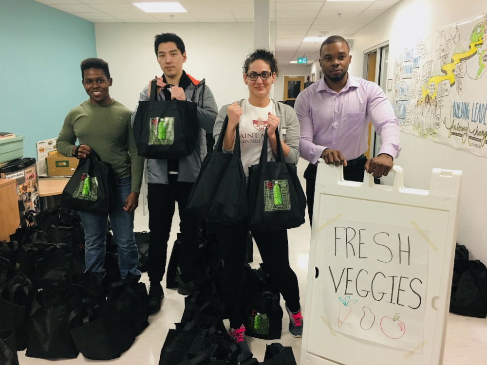 Service learning students working with the Square Roots Bundle Program:  (l-r) Joseph Henry, Hongwoo Kim, Stephanie Ibrahim, Gavin Grant