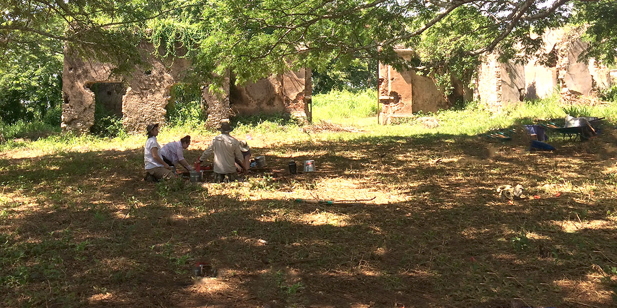Students unearthing artificacts at the Angerona Plantation archaeology site.