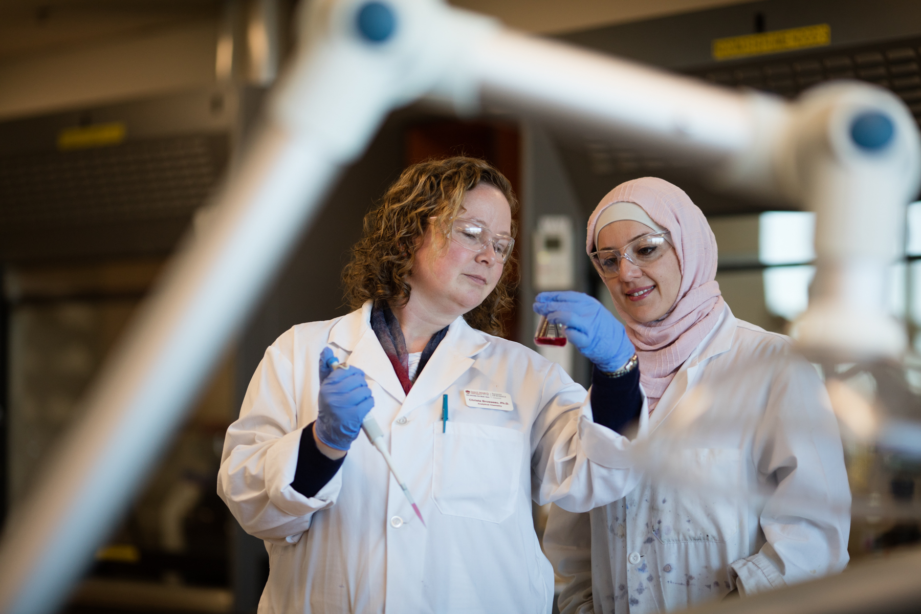Saint Mary's professor Dr. Christa Brosseau, Canada Research Chair in Sustainable Chemistry & Materials works in the lab with Ph.D. student Najwan Albarghouthi.