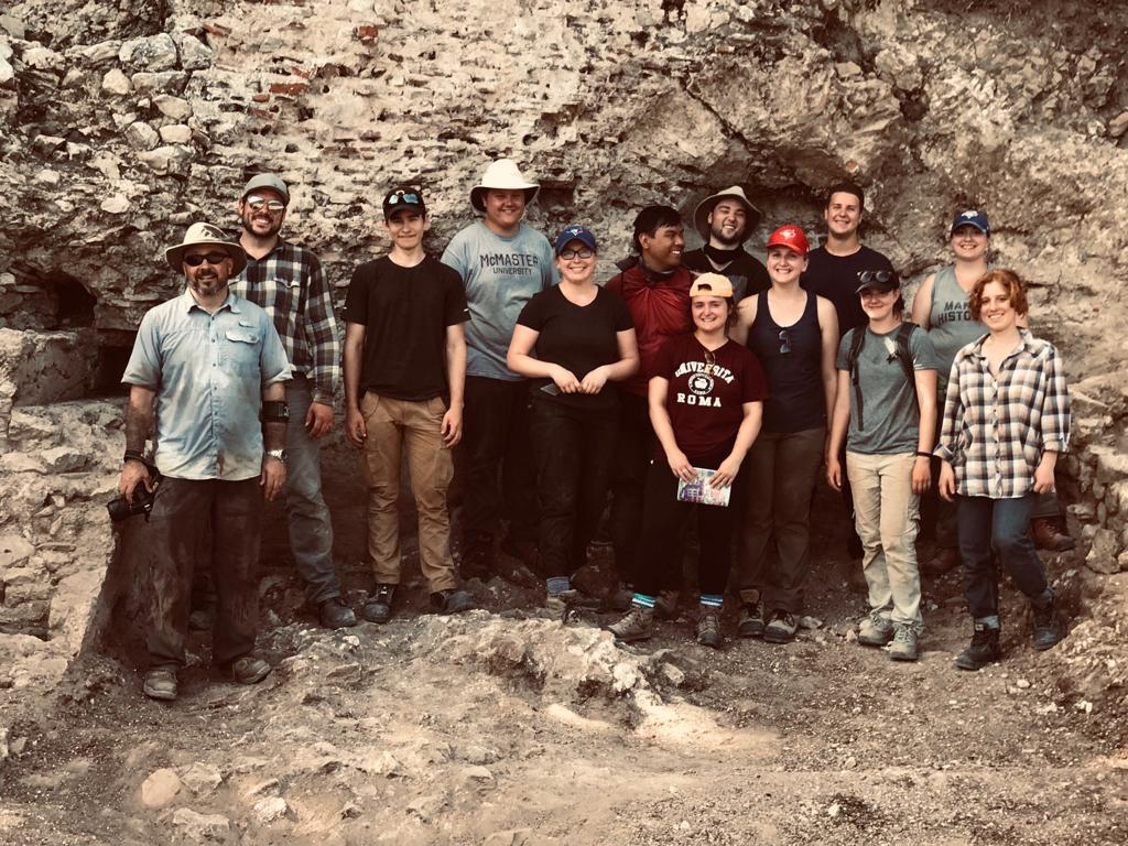 Dr. Myles McCallum with students from the Villa of Titus Archaeological Research Project.
