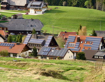 InsideClimate News /Osha Gray Davidson   Solar panels cover the rooftops of a German farming village.