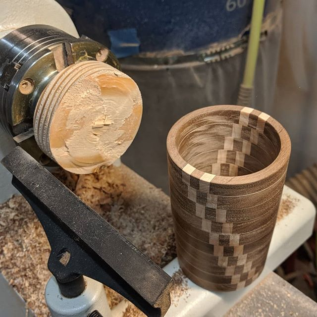 Finally made it back to my dad's shop to finish off the cup I started earlier this summer. The end grain didn't fare as well, but overall I really like how it turned out. Just need to clean up the bottom and add some finish.  #lathe #turning #woodworking #maple #walnut