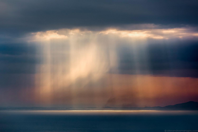 Sunrays Illuminating Rain |© Alexandros Maragos