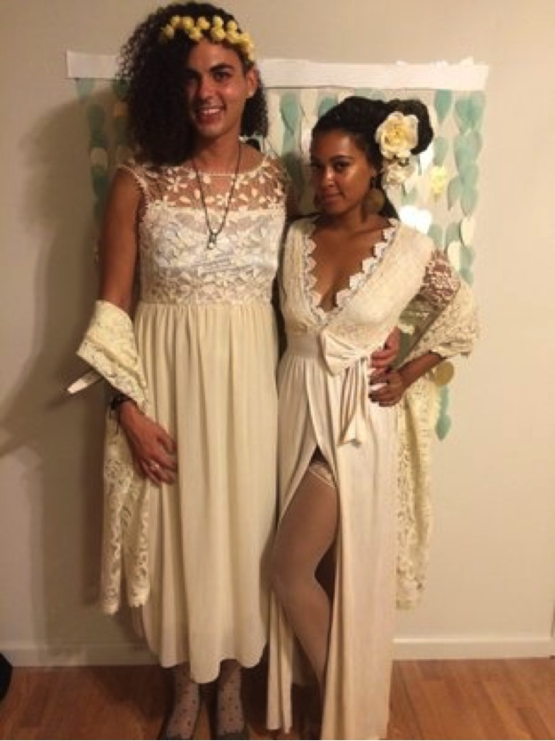 Abeni Jones.  [Photo description: The author and her friend pose for the camera wearing cream dresses with lace accents and flowers in their hair.]