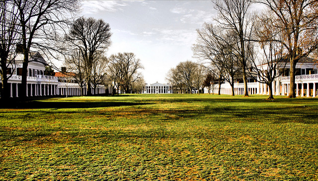 """[Image description: photograph of the South end of """"The Lawn"""" at the University of Virgina. The expanse of dry grass is framed by a few bare trees, and several buildings supported by white pillars.]   Phil Roeder / Creative Commons"""