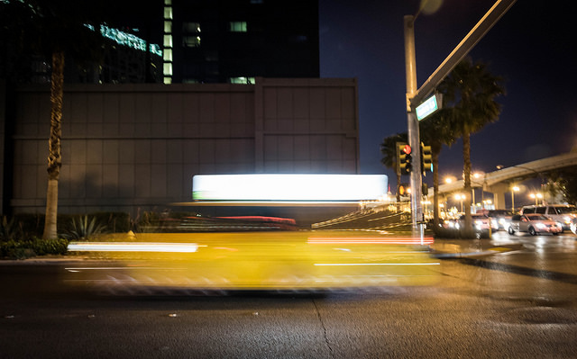 [Image description: photograph of a taxi driving at night. It blurs as it passes by the camera.]  Paul K / Creative Commons