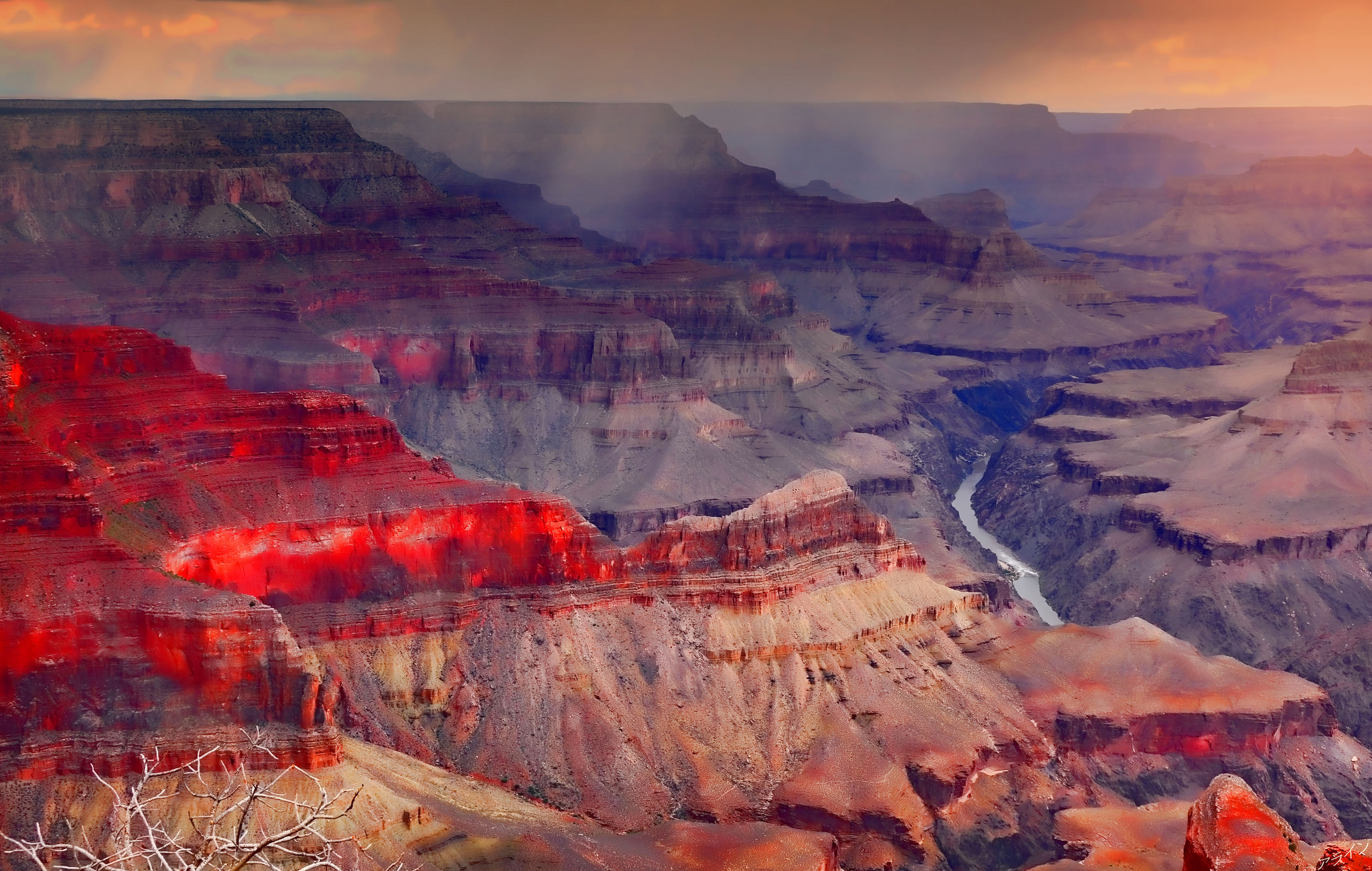 Alan E/ Flickr.    [Photo description: A misty, sunset-tinged view of the Grand Canyon from above.]