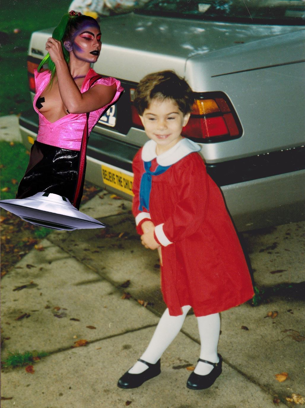 """[Image description: photo collage. A child wearing a red dress stands in a dance pose in front of a silver car with a bumper sticker that reads """"believe the child"""". In the upper left corner of the image, an adult with long green hair and dramatic makeup floats atop an UFO.]  Photo credit Gia Gigler"""