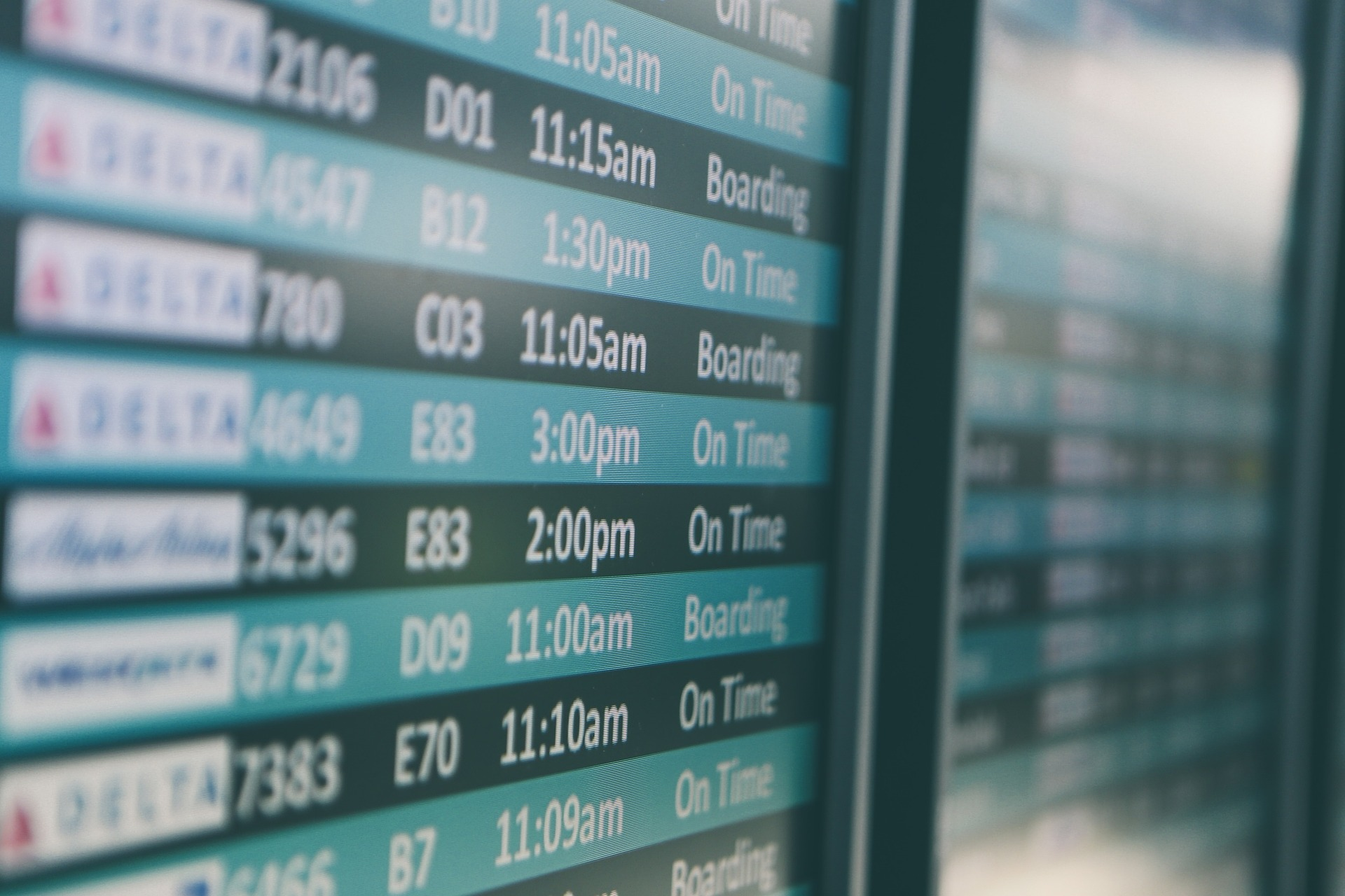 [Photo description: a close-up of an airport screen listing various departing flights]  Creative Commons.